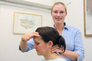 Attend2Health Louise Hampton Chiropractor palpating the neck to feel for any locked joints